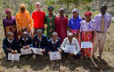 Prize winners display their certificates