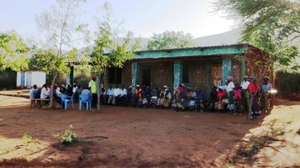 Kirumbi villagers waiting for a meeting with Kilele