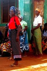 Kilele's sister Grace is amongst the villagers present