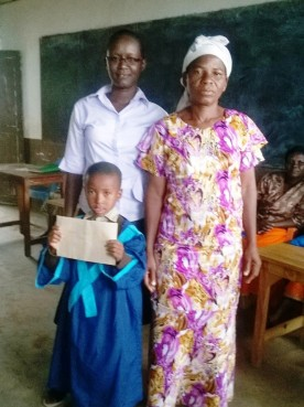 Madam Aggy and parent with new primary school pupil