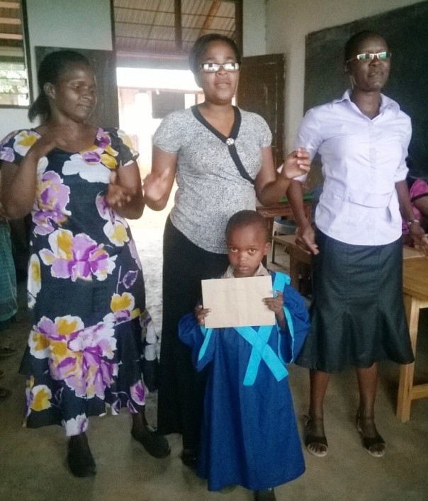 Madam Grace, Rojoice & Aggy with new primary school pupil
