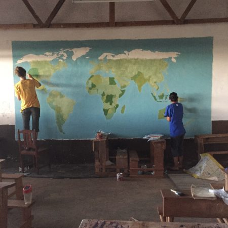 The mural of the world on the class room wall
