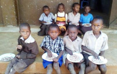 5 thumbnail2 - Children having their lunch.This the rice and beans i bought at the begining of the term.